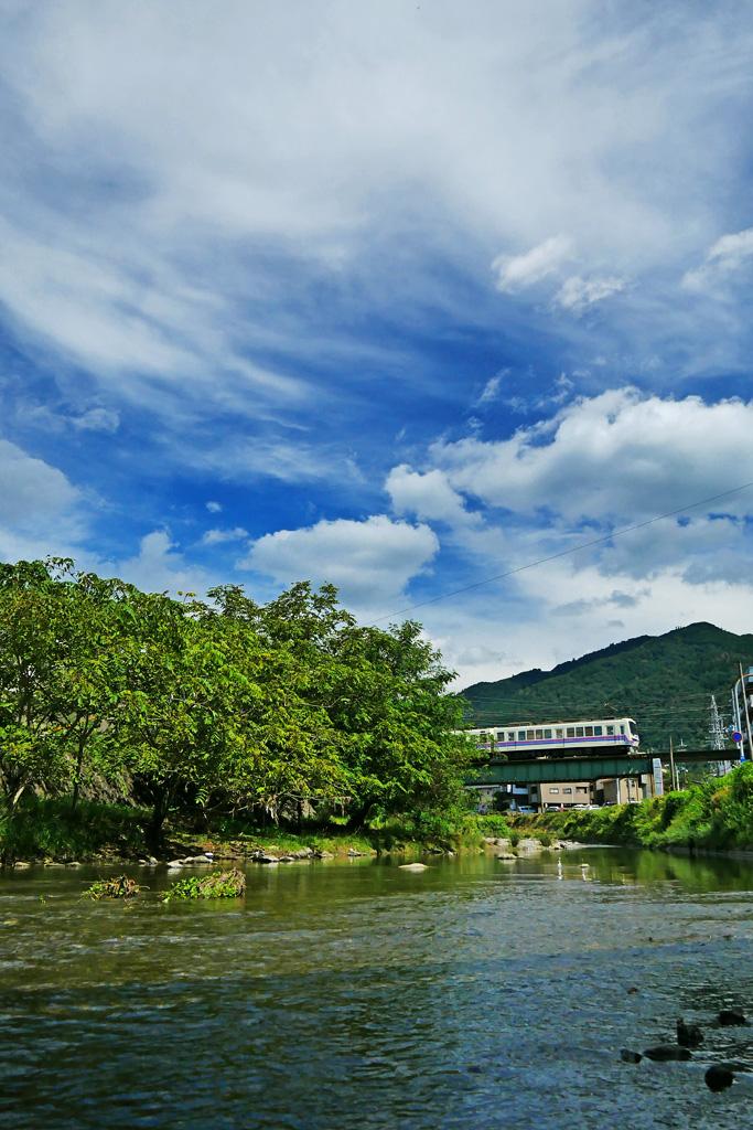 花園橋 叡電と比叡山の写真素材