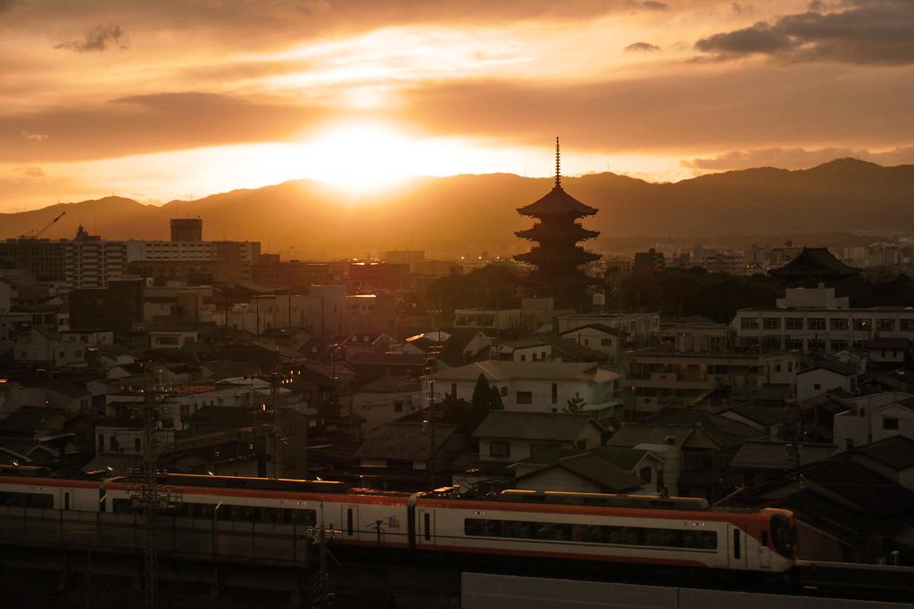 東寺の五重塔と近鉄電車の写真素材
