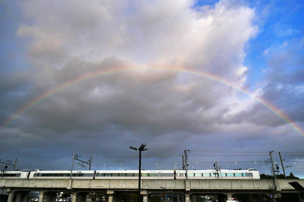 虹とJR山陰線の写真素材
