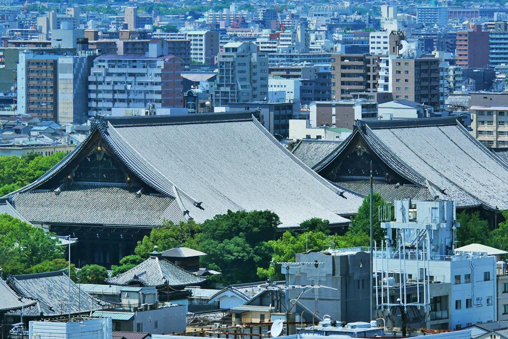 西本願寺とビル群 京都の写真素材