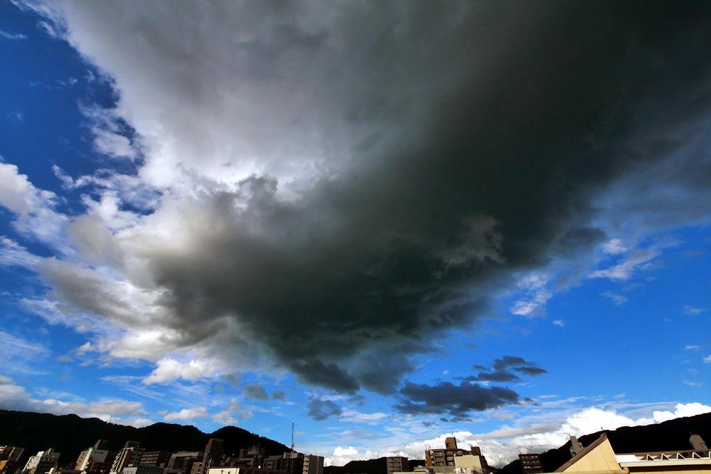 青空と黒い雲の写真素材