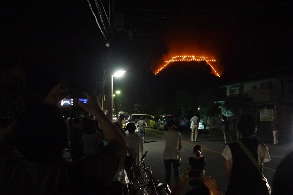 鳥居形の送り火の写真素材